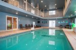 Indoor swimming pool has a retractable pool cover for safety when not in use