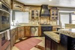 Custom kitchen with high-end appliances and ample counter space