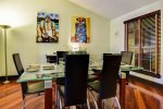 Formal dining with beautiful Brazilian wall art inspired by the owner`s homeland Brazil