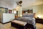 Master bedroom with comfortable king bed, ceiling fan, and adjoining master bath
