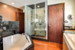 Master bathroom with amazing custom spa steam shower with multiple shower heads and tub