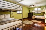 Bedroom 3 accommodates 8 people with two full-size bunk beds and ceiling fan