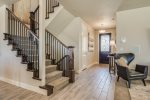 Entry foyer, stairs to the upper level and basement
