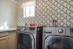 Laundry room with deluxe front loading washer and dryer