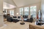 Comfortable family room open to dining area with leather sofas and TV