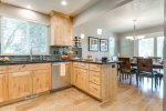 Beautifully finished kitchen with wood floors, custom tile back splash and granite counter tops