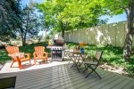 Relax on private shaded backyard patio with barbecue and hot tub