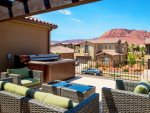 Private hot tub with balcony seating and a gorgeous view of Snow Canyon