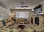 Family room with fireplace, comfortable sofa seating, and large TV