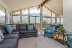 Large open family room with floor-to-ceiling windows and comfortable seating