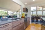 Remodeled modern kitchen with bar seating