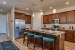Deluxe kitchen with granite counters and stainless steel appliances
