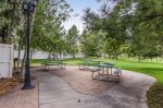 Community common area park with picnic table and BBQ