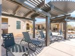 Pergolas provide poolside shade