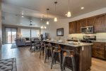 Kitchen with bar seating and deluxe appliances