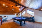 Game room with billiards, bar, and family room in walk-out basement