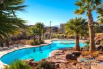 2-tier resort pool is just a 5 minute walk from this home, guests can enjoy unlimited access to the clubhouse amenities