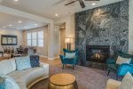 Modern stone fireplace and gathering area at 89