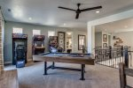 Game room with a pool table and arcades at 87