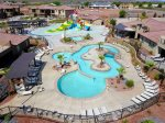 Luxury 2-tier resort pool with a natural rock water slide, grotto and shamu kids pool