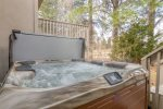 Private hot tub backs to green space