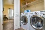 High end front load washer & dryer - Upstairs in hallway