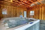 Private indoor hot tub in garage