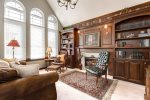 Beautiful den w/ library of books, marble gas fireplace, queen sofa sleeper