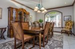 Spacious formal dining room with large dining table for 8