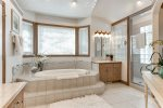 Jetted tub and shower with custom floor and shower tile