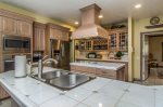 Chefs dream kitchen with gas cooktop island and new deluxe stainless steel appliances