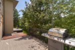 Private deck, hot tub, and BBQ in shade trees off kitchen area