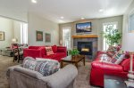 Family room off kitchen, enjoy the fireplace and TV