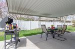 Covered back patio with outdoor dining space and a BBQ