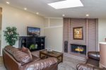 Cottonwood Cove Unit 2, spacious living room furnished with comfortable seating, a TV, and fireplace