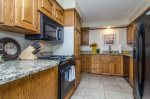 Fully stocked kitchen with appliances and utensils in unit 2, perfect for guests looking to cook while on vacation