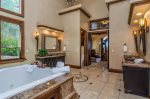 Master Suite Bathroom stunning marble and stone floors and shower, jetted roman tub