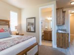 Casita master suite with kitchenette, private bathroom, and separate entrance to entry courtyard