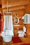 Holly Hill Ocoee River area cabin rental- master bath with claw foot tub