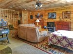 Holly Hill Ocoee River area cabin rental- lower living area with full size bed