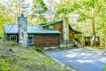 Spacious cabin w/ hot tub, wifi, dry sauna, firepit, & two fireplaces Pet friendly