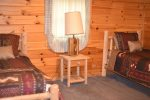 Log beds in this Blue Ridge area cabin rental