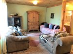 Toccoa river cabin rentals-lower level living area with futon and full bath