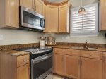 Beautiful kitchen in main house with stainless appliances and granite counters