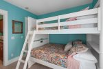 Bunk room on 1st floor of carriage house with two full-over-full bunks.