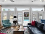 Living area with lots of windows and light and plantation shutters abound,