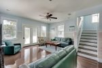 Open living area with new furniture and beautiful whitewashed wainscoting.