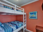 BRAND NEW queen-over-queen built-in bunk beds; flat screen TV
