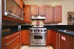 Beautiful cook`s kitchen with granite & stainless appliances