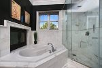 Imagine a luxurious soak in this tub next to the fireplace